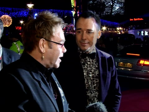Red carpet interviews at premiere of 'It's a Boy Girl Thing' Furnish interview / Elton John interview SOT On success of 'Take That' boy band revival/...