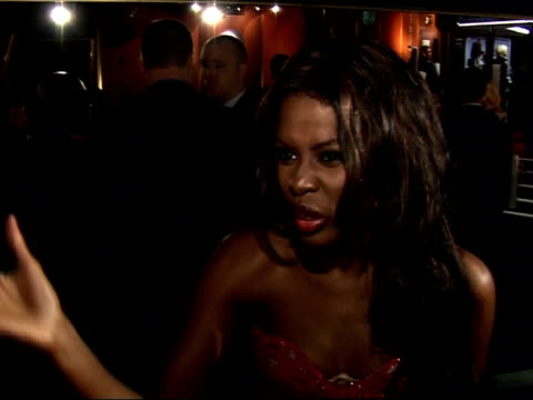stockvideo's en b-roll-footage met red carpet interviews at 'pursuit of happyness' premiere; june sarpong speaking to press sot - on excitement at seeing smith in film / on change in... - atlete