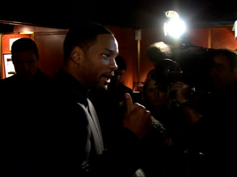 red carpet interviews at 'pursuit of happyness' premiere will smith speaking to press sot on film's scene in public lavatory where gardner and his... - an answer film title stock videos & royalty-free footage