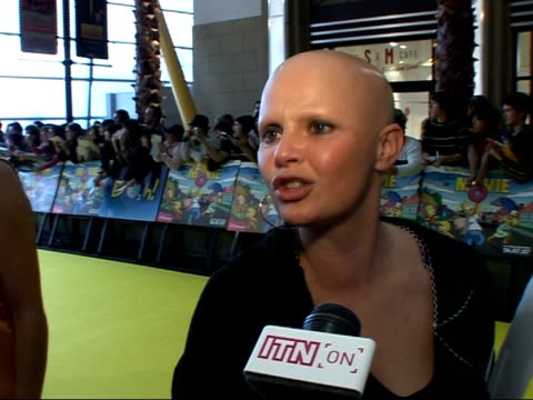 red carpet interviews at the simpsons movie film premiere gail porter interview sot really excited to be seeing the movie / marge is favourite... - hoop earring stock videos and b-roll footage