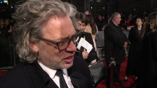 red carpet interviews from the ee british academy of film and television arts film awards at london's royal albert hall interviews with henry golding... - barry jenkins film director stock videos and b-roll footage
