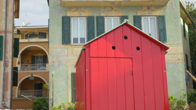red changing booth shed in a luxury resort town in italy, europe. - slow motion - goodsportvideo stock videos and b-roll footage