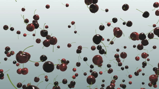 cgi red cherries thrown in air against gray background - digital animation stock videos & royalty-free footage
