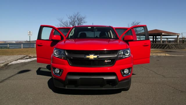 a red chevrolet truck parked in a parking lot along a water front in new york city new york on march 12th 2015 shots exterior wide shots of the red... - chevrolet truck stock videos & royalty-free footage