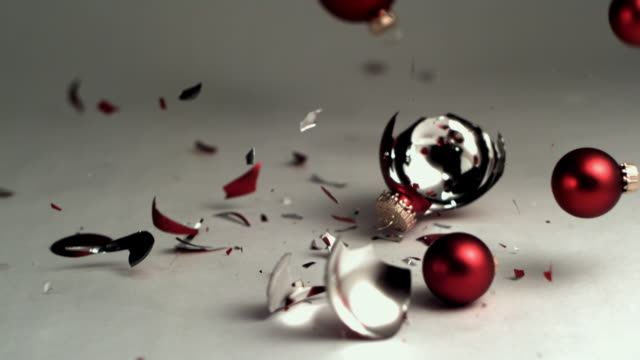 SLO MO, MS, Red Christmas balls falling and breaking