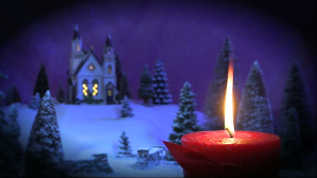 red christmas candle with church on hill - vignette - vignette stock videos & royalty-free footage