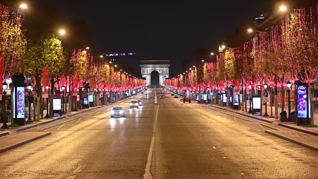 red christmas lights decorate the trees to illuminate the champs-elysees avenue with the arc de triomphe in the background for christmas celebrations... - triumphal arch stock videos & royalty-free footage