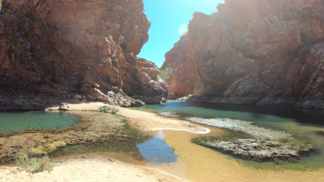 red cliffs reflected in waterhole, ellery creek big hole, west macdonnell ranges, northern territory in central outback, australia, pacific - clear sky stock videos & royalty-free footage