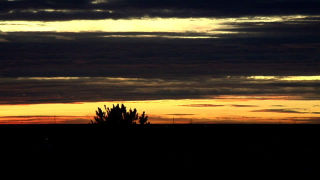 vidéos et rushes de red cloud sunrise, timelapse - altocumulus