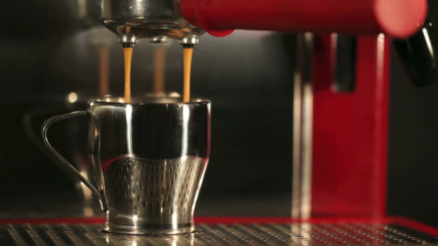 red coffee machine pouring espresso - cafe macchiato stock videos and b-roll footage