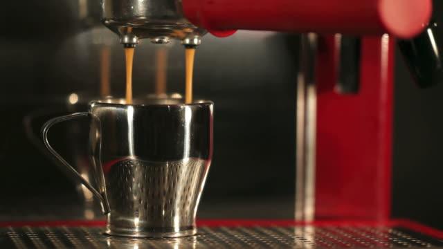 Red Coffee Machine Pouring Espresso