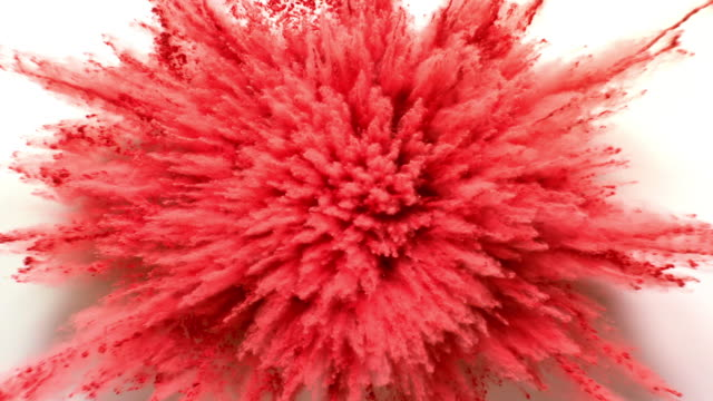 red colored powder exploding towards camera in close up and super slow-motion, white background - backgrounds stock videos & royalty-free footage