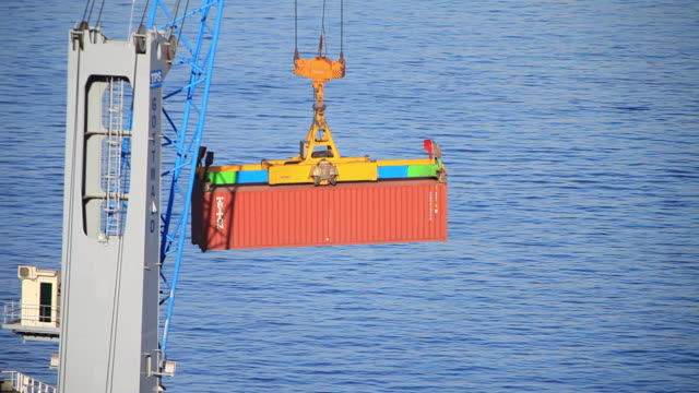 ms pan red container being moved by crane / valparaiso, valle central, chile - crane stock videos & royalty-free footage
