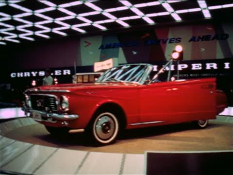 1965 red convertible with door open on spinning platform in car show / detroit / industrial - automobile industry stock videos & royalty-free footage
