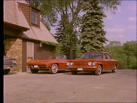 1963 red corvair pulls into drive with corvette and impala / couple gets out of corvair - 1963 stock videos & royalty-free footage