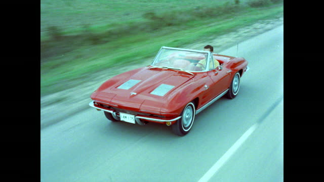 Red Corvette Convertible Driving, High Angle