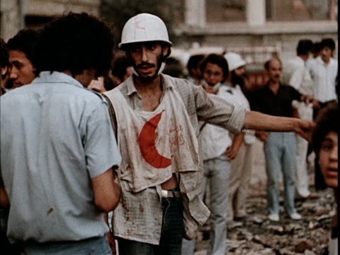 red crescent members people trying to dig out survivors from a bombed out apartment building / soviet propaganda film about the 1982 lebanon war - beirut stock videos & royalty-free footage