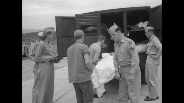 vídeos de stock, filmes e b-roll de red cross ambulance driving up to c54 on itazuke air base airfield / group of military people stand by plane back of ambulance in fg pan to rc emblem... - neckwear