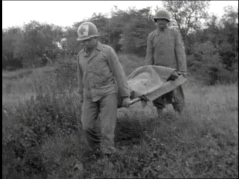 red cross carefully carries wounded soldier down an embankment on a stretcher - 1944 stock videos and b-roll footage