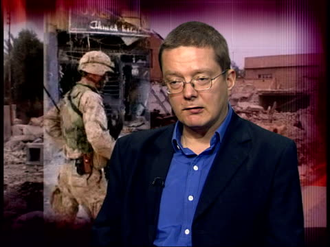 red cross cruelty comments/ fallujah graves/ attacks; itn england: london: int dr toby dodge interview sot - elections look very unlikely at end of... - アルファルージャ点の映像素材/bロール