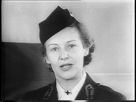 stockvideo's en b-roll-footage met red cross flag flapping / movie star, madeleine carroll fills out paperwork to enlist / in her new uniform to be a hospital staff aid / she speaks... - in dienst gaan