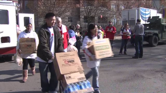 red cross hands out supplies after hurricane sandy on november 16, 2012 in staten island, new york - red cross stock videos & royalty-free footage