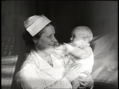 red cross nurses hold babies and proudly carry the american flag - patriotism stock videos & royalty-free footage