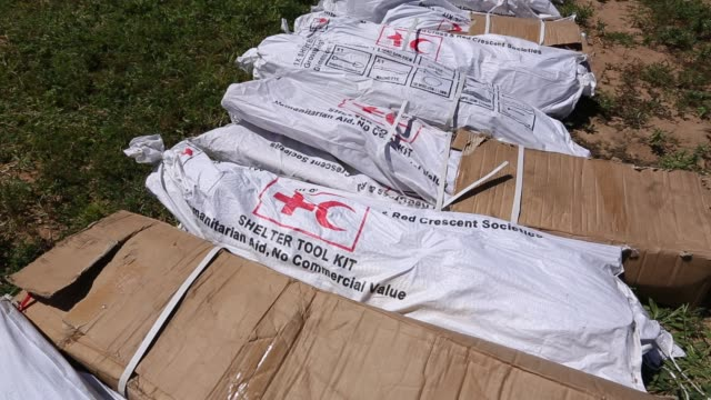 red cross shelter tool kits waiting to be airlifted into flood affected areas in bangula, malawi on march 16th 2015. in mid january 2015, a three day... - united nations stock videos & royalty-free footage
