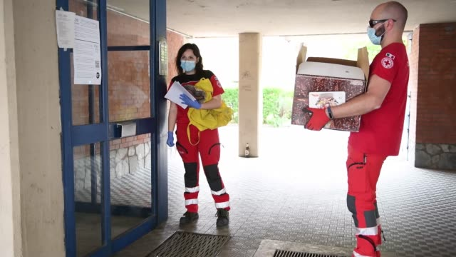 red cross volunteers deliver boxes of donated food to families in need during the current coronavirus epidemic at the turin red cross headquarters on... - red cross stock videos & royalty-free footage