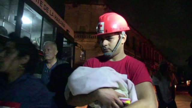 red cross volunteers evacuate mothers with babies from a hospital in havana as a rare and powerful tornado hit the cuban capital killing three people... - soccorritore video stock e b–roll