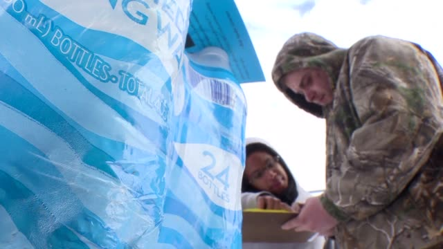 red cross volunteers have been delivering bottled water to flint residents since early january after the lead contamination of the towns tap water a... - michigan stock videos and b-roll footage