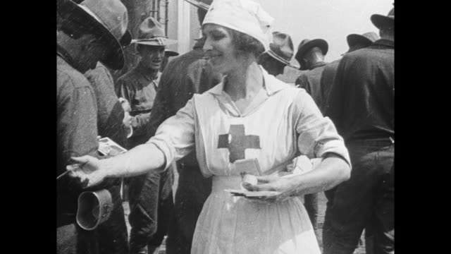 red cross woman handing out information at red cross canteen service - red cross stock videos & royalty-free footage