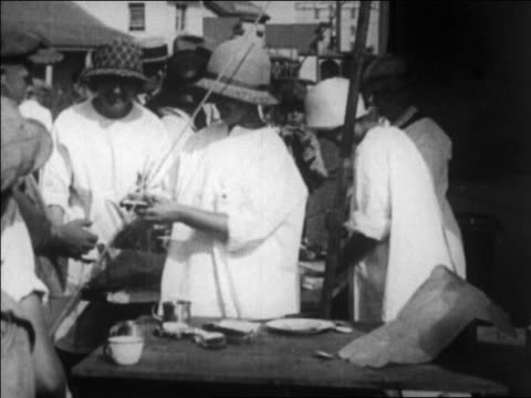 red cross workers making sandwiches giving them to people after earthquake / ca - 1925 stock videos & royalty-free footage