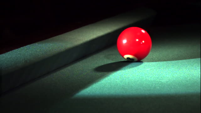 a red cue ball bounces off the side of the billiards table. - cue ball stock videos & royalty-free footage