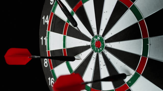 SLO MO of red dart richocheting off a dartboard