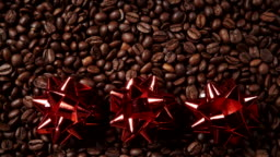 Red decorative bows on coffee beans