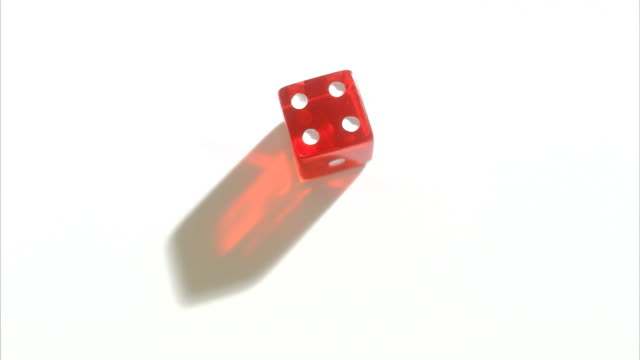 red dice against white background. - dice stock videos & royalty-free footage