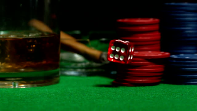 red dice falling on casino table - craps stock videos & royalty-free footage