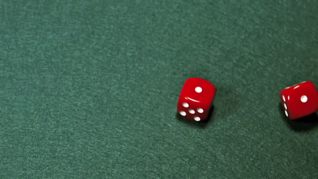 cu slo mo red dice rolling against green background / vieux pont, normandy, france - still life stock videos & royalty-free footage
