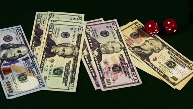 """red dice rolling on dollar bills, slow motion"" - twenty us dollar note stock videos & royalty-free footage"