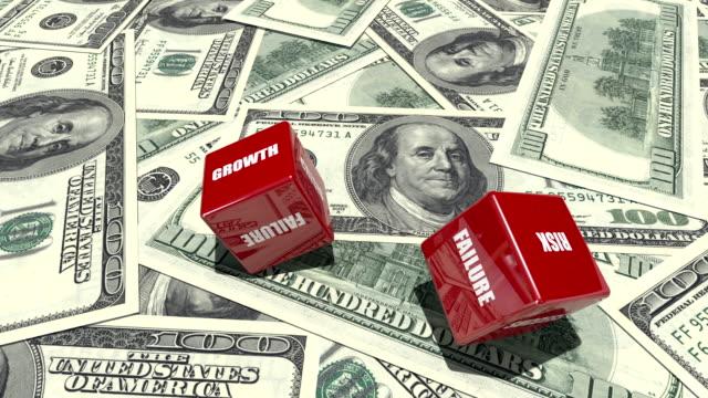 Red Dice with Business Words on Dollar Backgorund
