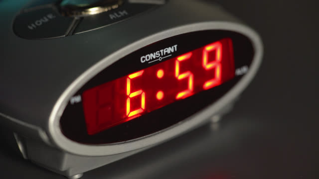 red display on a digital alarm clock changes time - routine stock videos & royalty-free footage