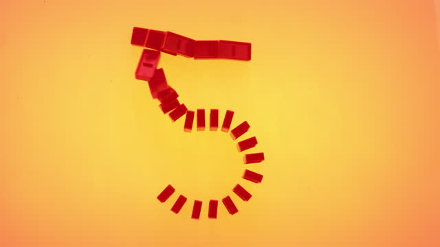 "slo mo ld red domino tiles shaped as the number ""5"" falling on orange surface - number 5 stock videos & royalty-free footage"