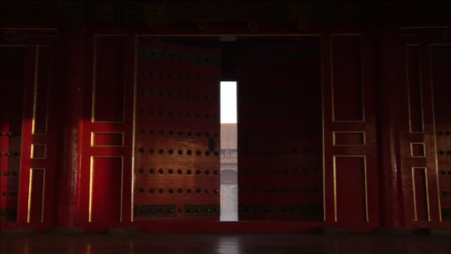 Red doors open into the courtyard of the Imperial Palace.