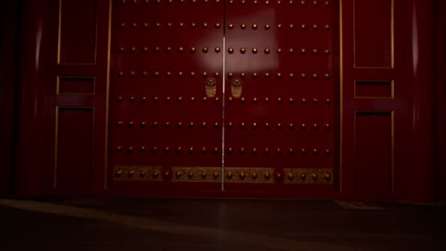 red doors opening onto the courtyard of the forbidden city. - doorway stock videos & royalty-free footage