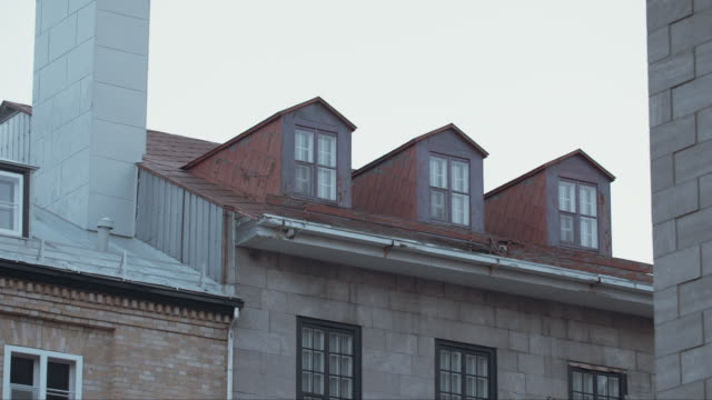 red dormer windows on roof in quebec city - dormer stock videos and b-roll footage