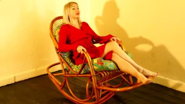 red dresses woman with rocking chair - cross legged stock videos & royalty-free footage
