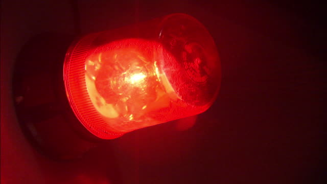 A red emergency light spins.