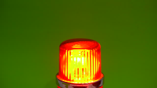 red emergency siren lamp rotating in chroma key - danger stock videos & royalty-free footage