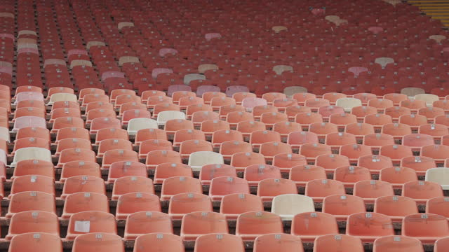 red empty plastic seats in a stadium in a row. - stage performance space stock videos & royalty-free footage